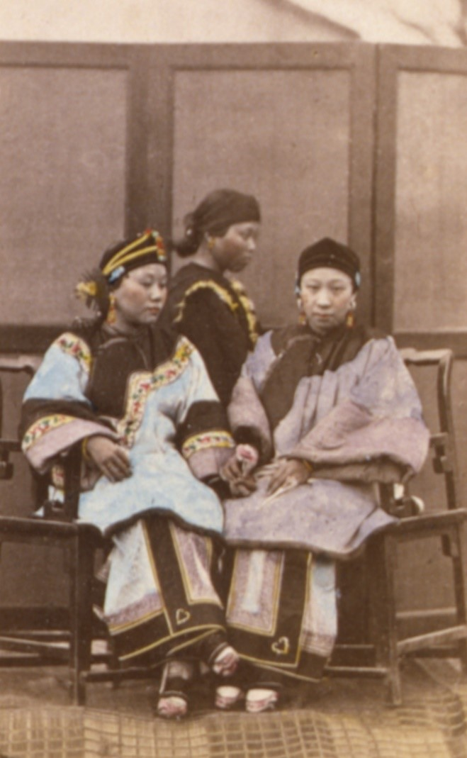 An early tinted photograph of two wealthy Han Chinese women with bound feet (c. 1870; courtesy of the Library of Congress, LC- LC-USZC4-14686).