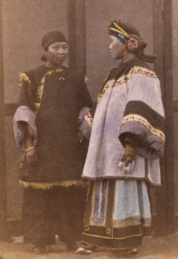 An early tinted photograph of a Chinese Han lady and her servant; both women have bound feet (c. 1870; courtesy of the Library of Congress, LC-USZC4-14684).