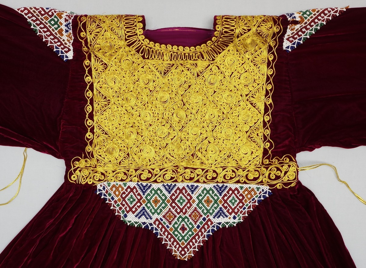 Detail of a velvet Pashtun wedding dress with a chest panel decorated with beading and passementerie (Afghanistan; TRC 2005.0251b).