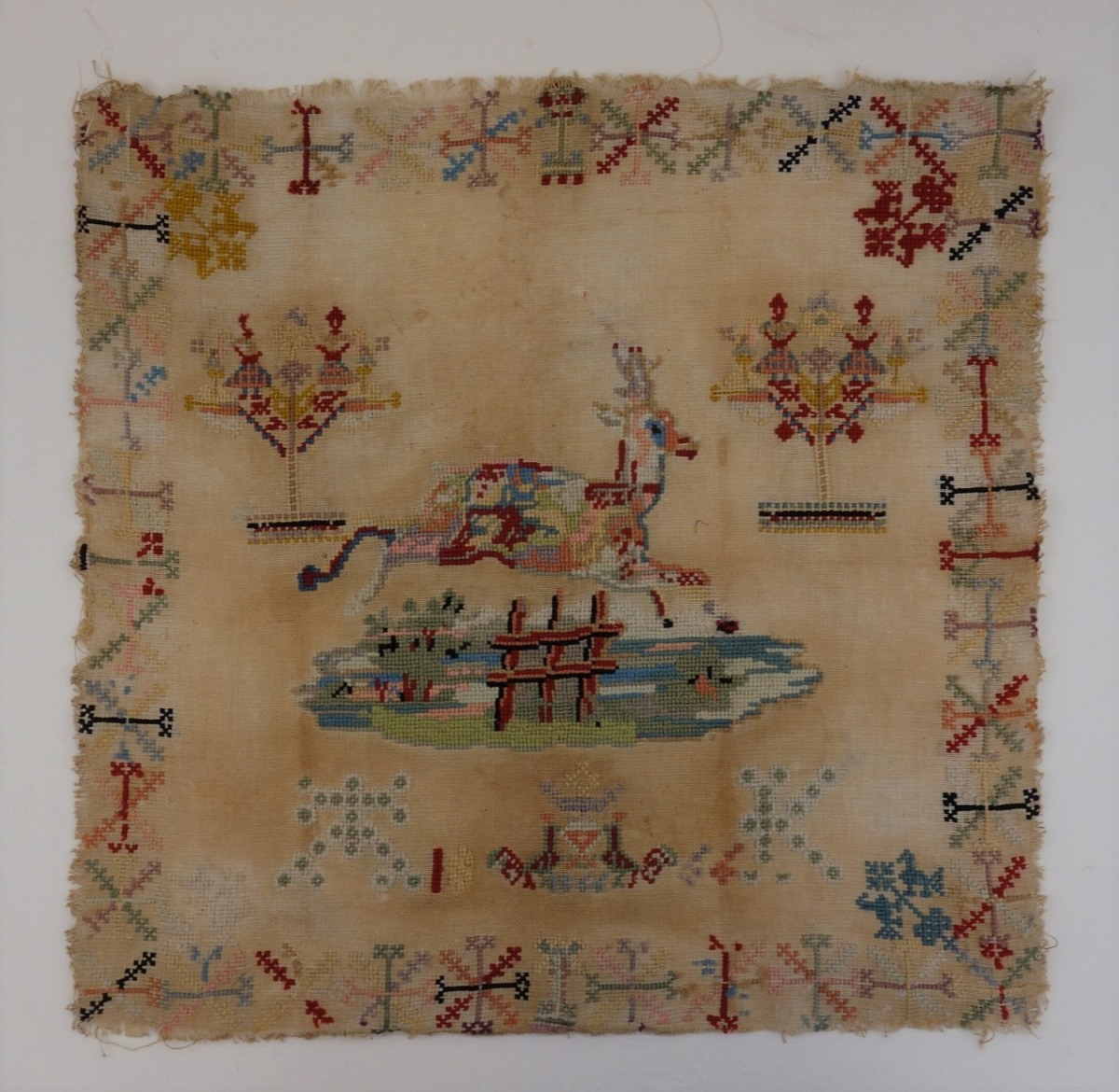 Embroidered Berlin work sampler, wool on linen, The Netherlands, 19th century.