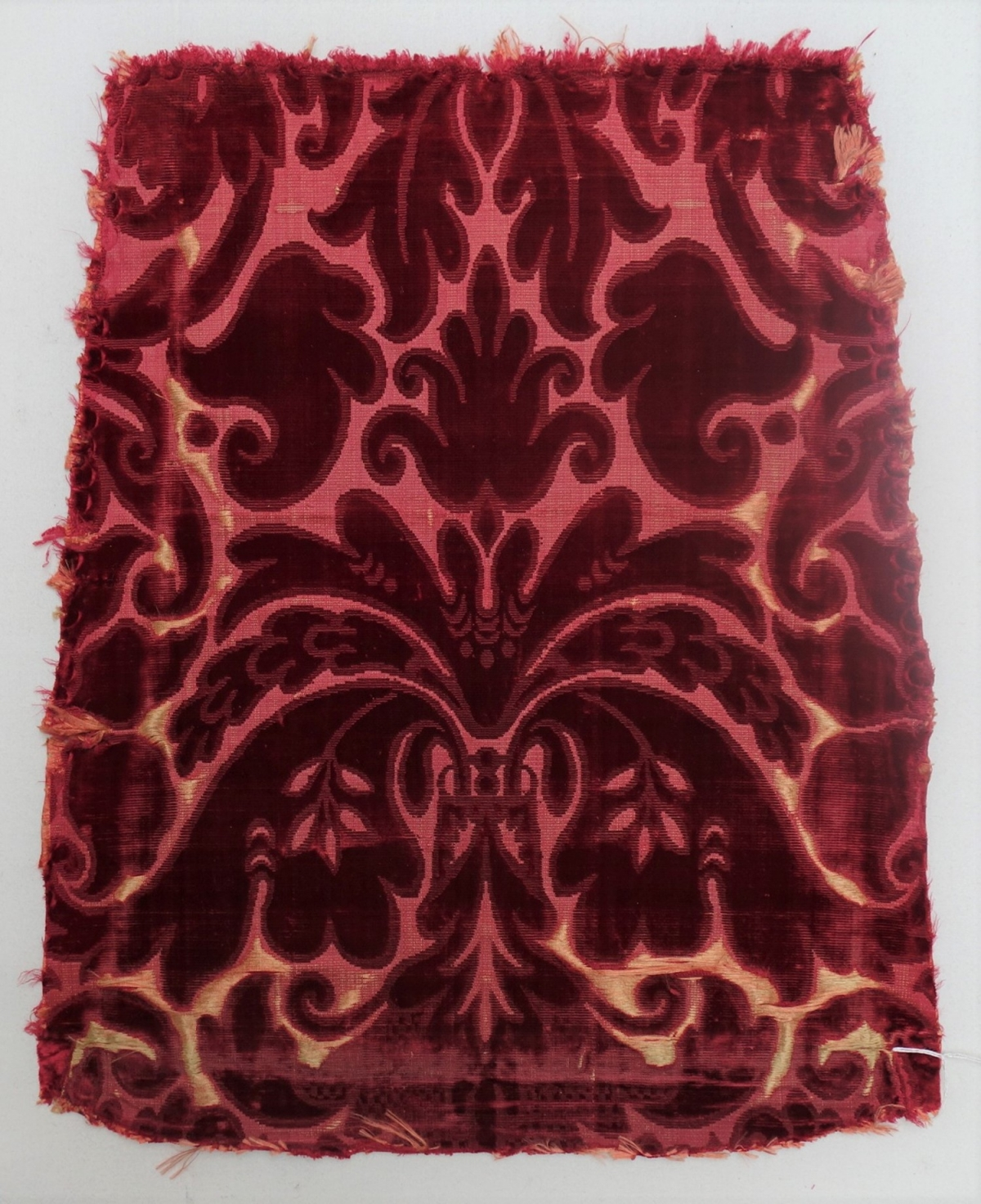 Chair cover in red cicelé velvet in silk (17th century, Europe; TRC 2011.0368).