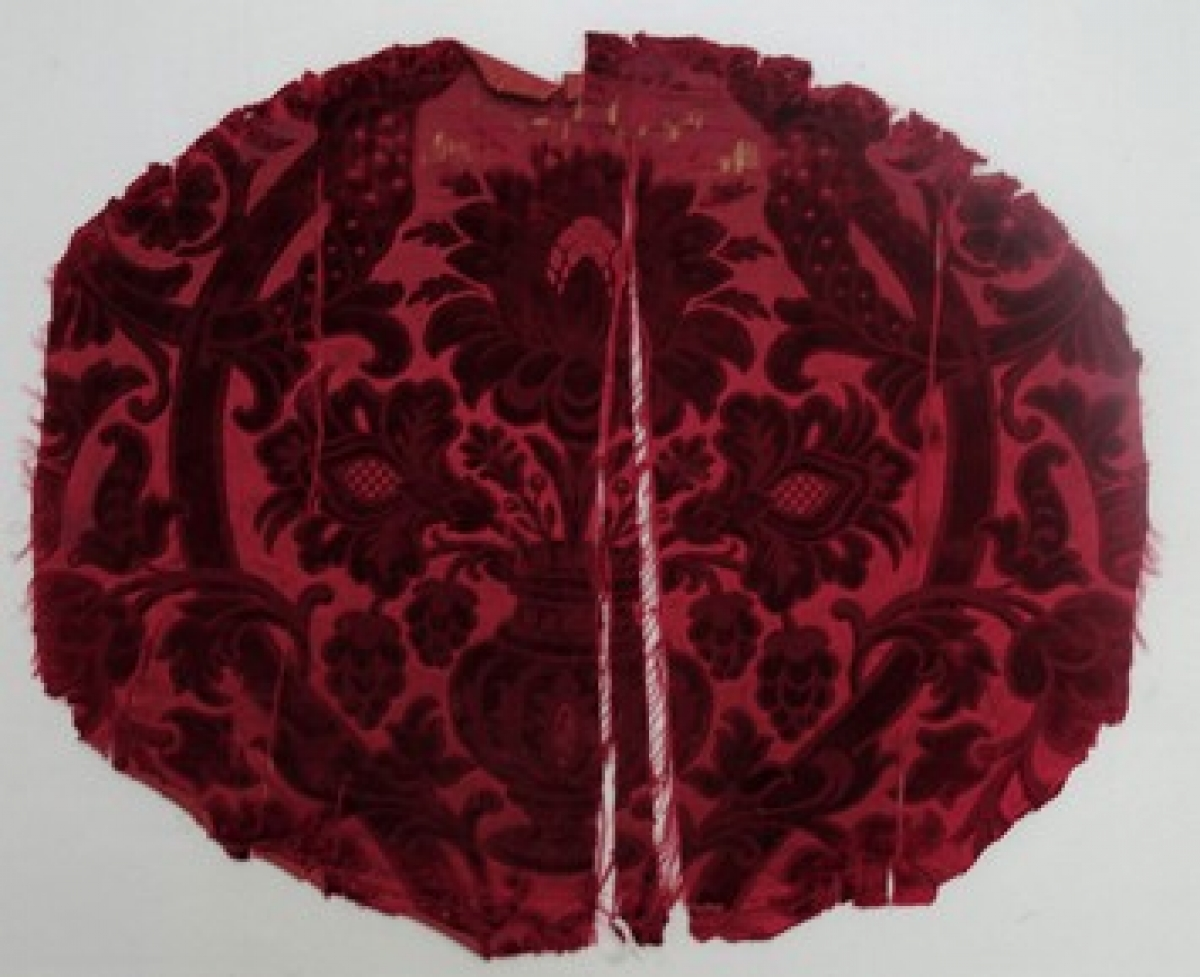 Chair cover made from a red silk, ciselé velvet from the 18th century, France (TRC 2011.0388).
