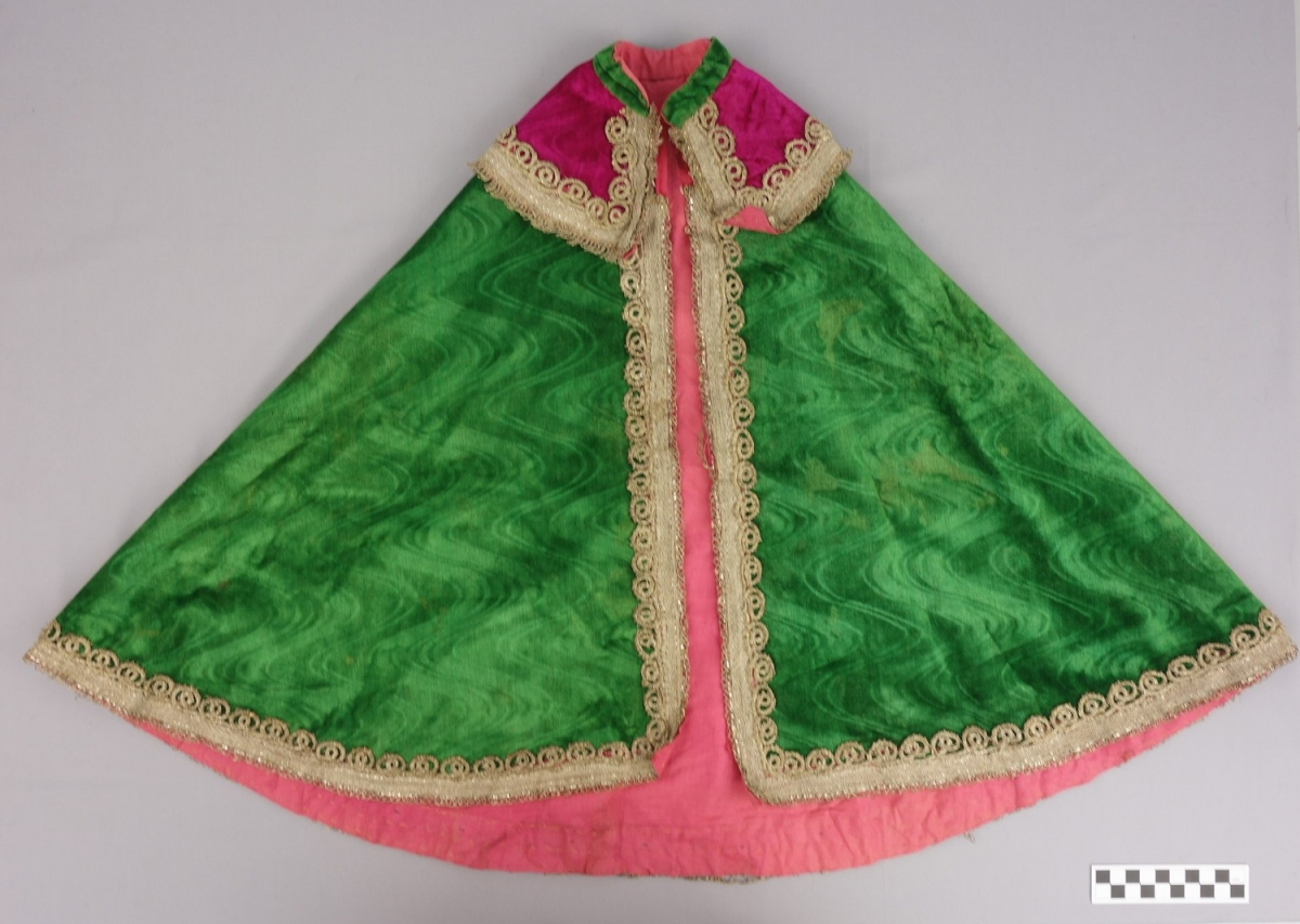 Girl's cape in green, silk velvet, with a pressed moire pattern (purchased in Iran, early 20th century; TRC 1998.0404).