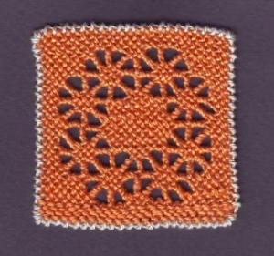 Example of Puncetto needlelace.