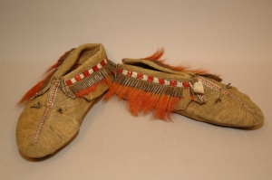 A pair of moccasins from the Northeast Indians (?) decorated with glass beads and moose hair tassels, 1860s.