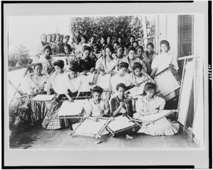 Embroidery class in Manila, early 20th century