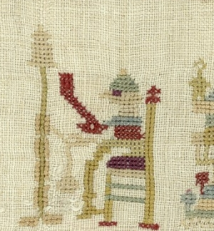 Spinning monkey, embroidered onto a mid-18th century sampler from Friesland, The Netherlands.