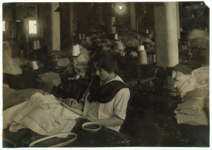 Photograph showing Helen Whitty, at work with hand embroidery.  Boston 1917.