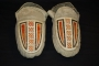 Pair of Esquimeaux Indian moccasins decorated with black, red and white porcupine quill work on the vamp. Acquired from the Hudson's Bay Company (early 19th century).