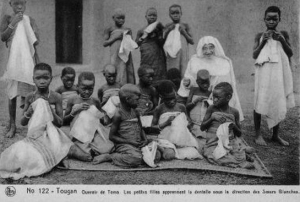 Photograph of the White Sisters teaching lace making, Burkina Faso, 1930.