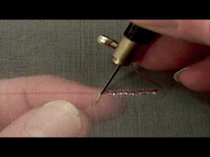 The process of tambour beading.