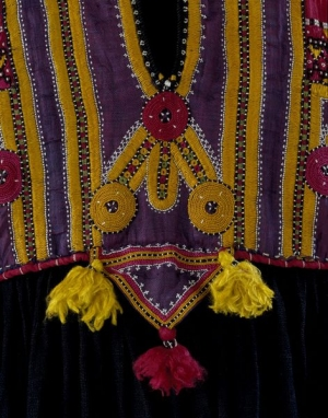Detail of a dress, Pakistan, 19th century, with triangular amuletic shape hanging down from the waistband.