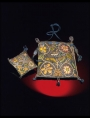 Early 17th century purse and pin cushion from England.