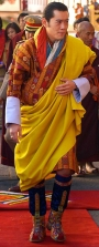 The King of Bhutan wearing the traditional tshoglham boots.