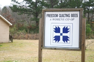 Freedom Quilting Bee sign, showing the Civil Rights emblem.