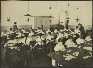 Photograph taken by Karl Karlovich Bulla, showing an embroidery lesson. Pre-Revolutionary Russia.