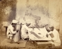Photograph of Indian gold embroiderers, dated 1873.