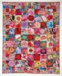 Seed packet quilt, designed by Kaffe Fassett.