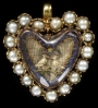 Gold pendant with a border of half pearls surrounding an embroidery under faceted crystal, c. 1700, England.