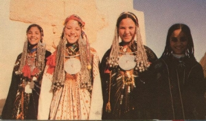 Siwa girls in their family's bridal outfits, late 20th century.