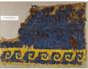 Fragment from a cloak, made of woven cotton with applied feathers. Peru, c. 900-1476.