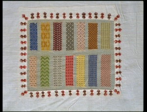 Long sampler of needlework, with a series of sampler panels. The cotton panels contain samples of plain sewing.
