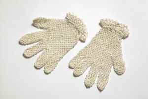 Pair of girls' gloves, early 20th century; crocheted cotton with tatted edging.