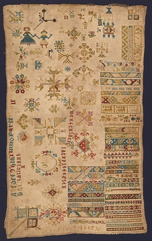 Dutch 17th century sampler, on display in the exhibition 'American and European Embroidered Samplers, 1600-1900'.