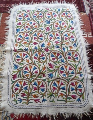 Example of a felt namdha floor covering with chain stitch embroidery. Kashmir.