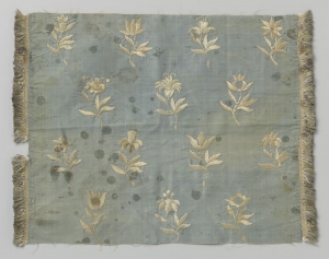 Embroidered blue silk with white floral embroidery, c. 1630