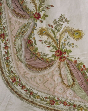 Fragment of a late 18th century French court mantua-style dress. It is made of mbroidered silk satin, with silks, velvet appliqué, chenille, metal purl and swansdown.