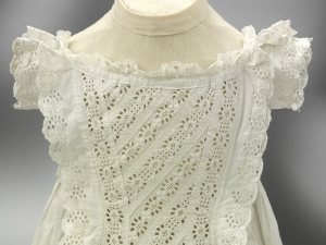 Baby's gown, linen with embroidered lace, England, c. 1860/1870.
