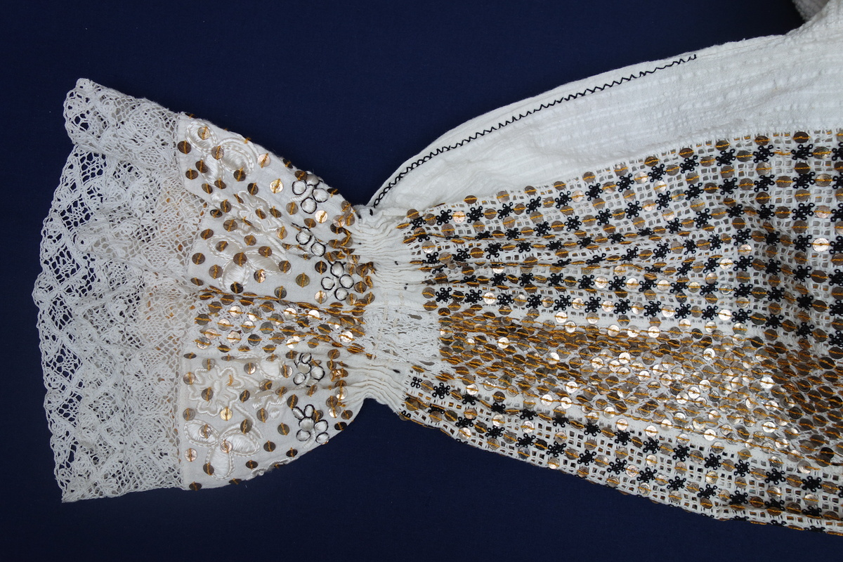 Detail of the woman's blouse from Croatia (TRC 1997.0067).