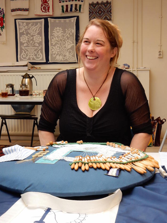 Marieke Roozeboom, one of the course participants, behind a bobbin lace pillow.