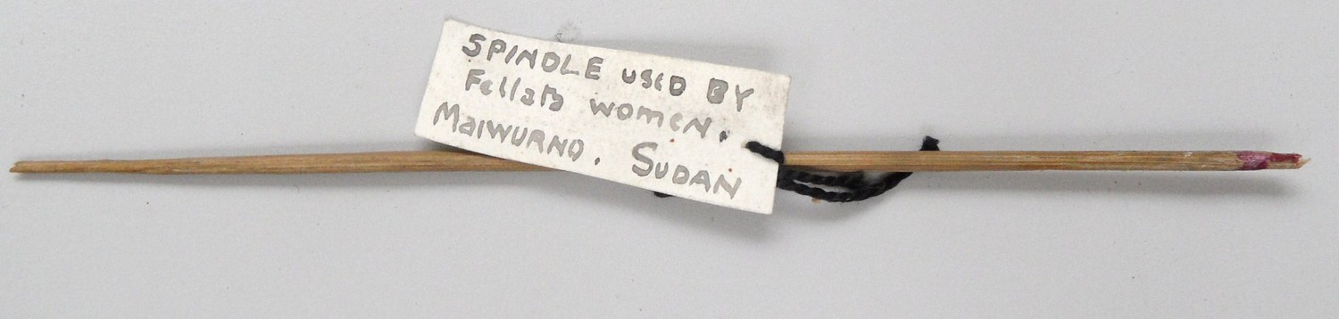 Nubian spindle shaft, 1920s, collected by Grace Crowfoot, with label with her handwriting (TRC 2014.0780).