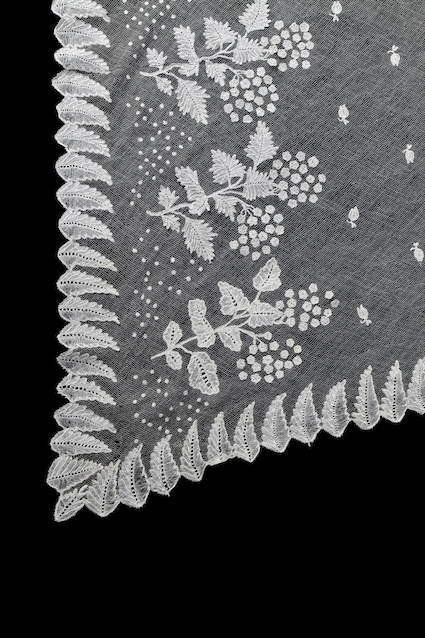 Detail of a christening veil made from Brussels net lace, c. 1820. TRC 2014.0831.