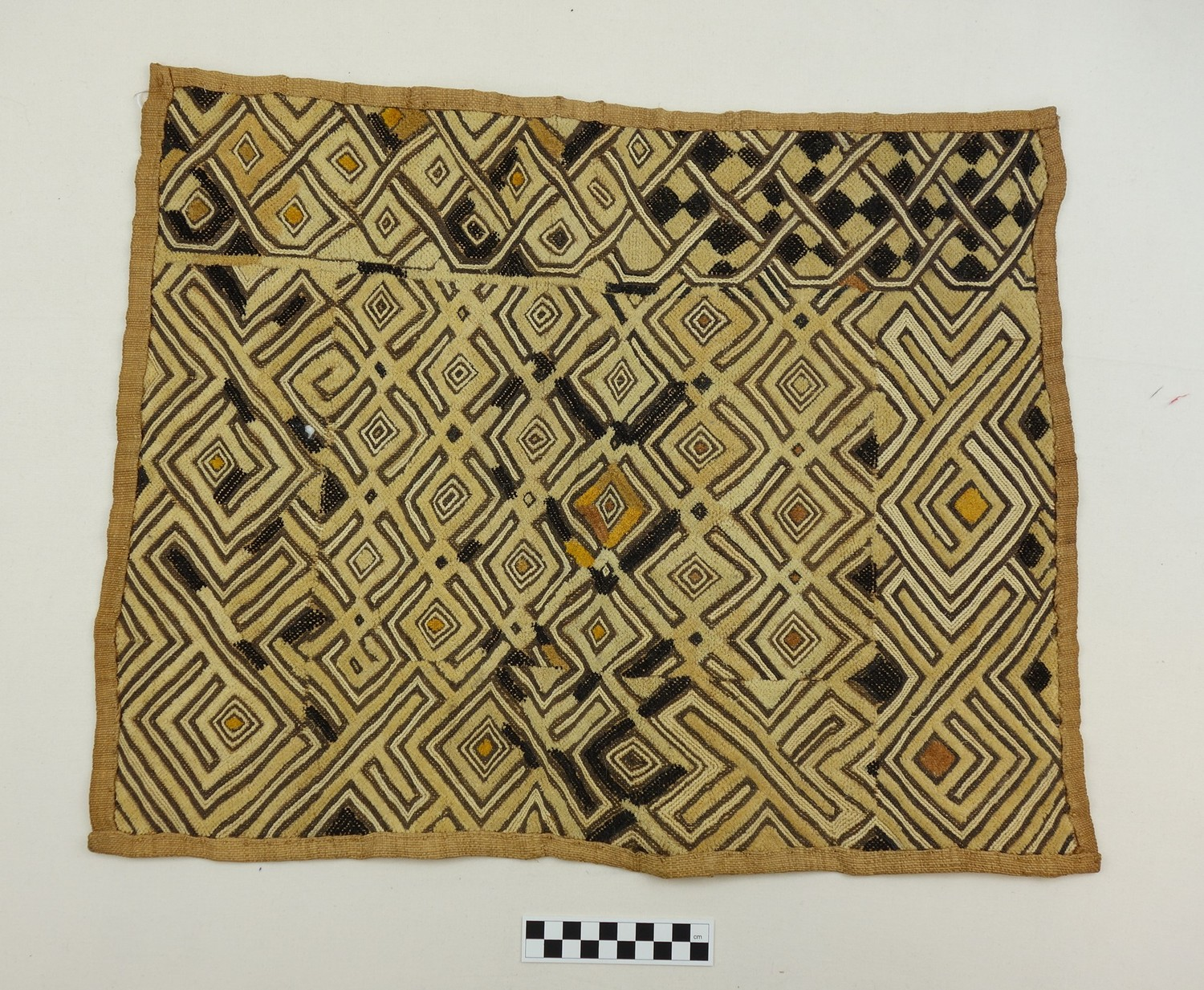 No. 76. Example of Kuba embroidered velvet in raffia (mid-20th century, Congo; TRC 2017.3292).