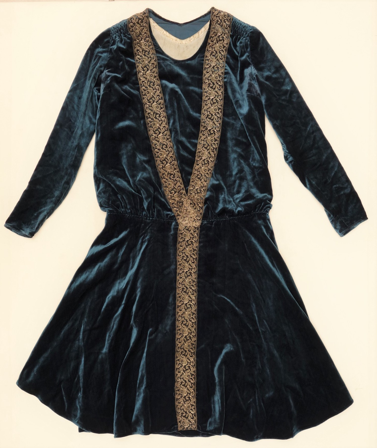 No. 96: Woman's velvet dress with gold coloured metal lace (c. 1920's, USA; TRC 2018.2621).