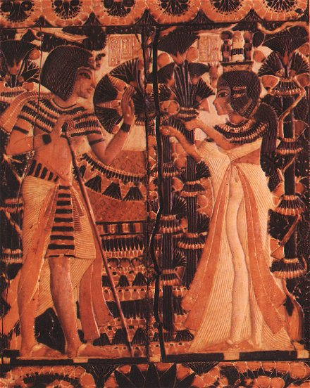 Side panel of a wood and ivory casket from the tomb of Tutankhamun, showing the king receiving flowers from Ankhesenamen.