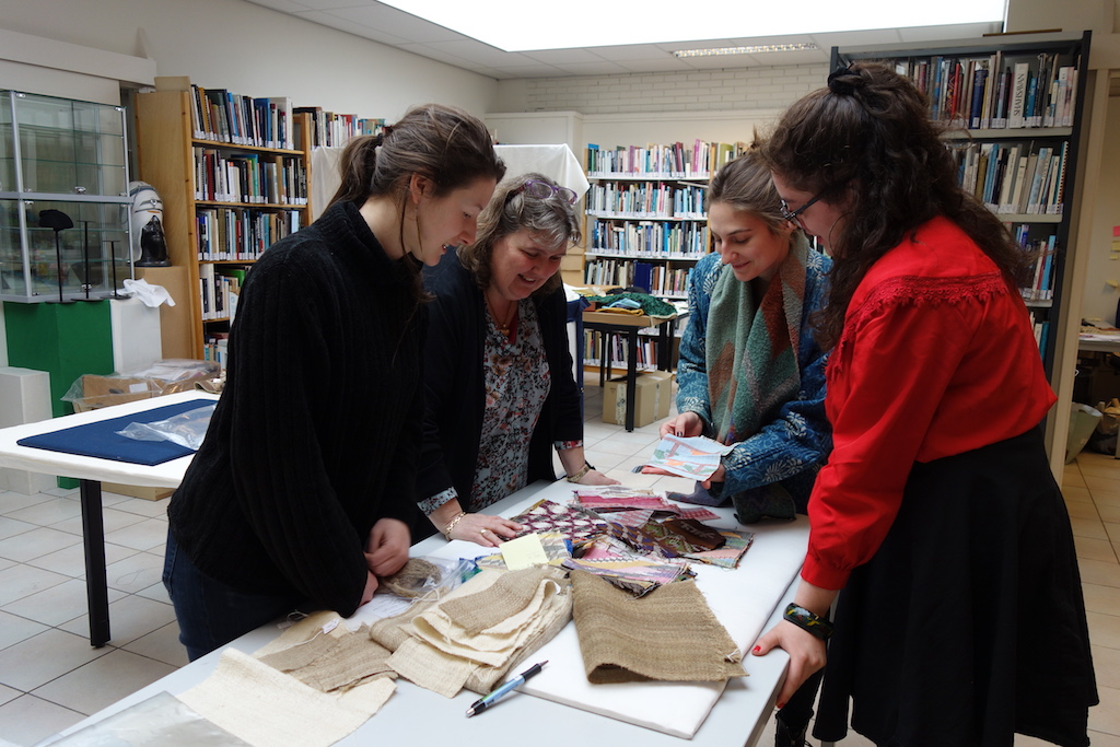 TRC colleagues going through the recent arrival of the Nepalese textiles.