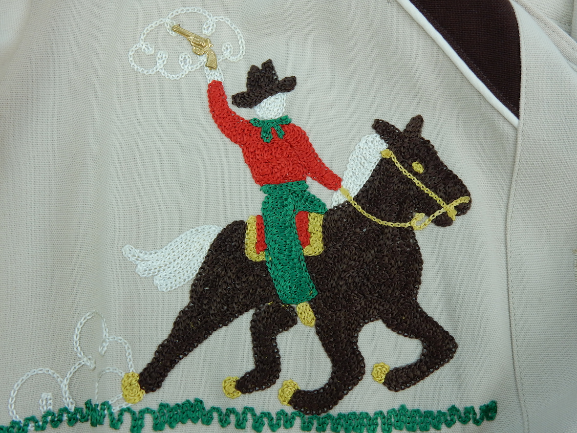 Detail of a cowgirl shirt embroidered with horserider. TRC 2017.0267
