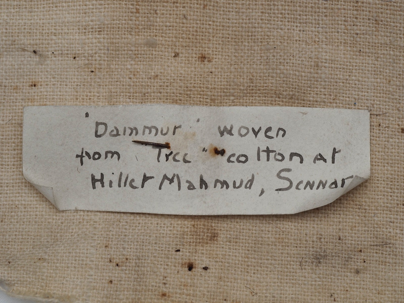 Label that goes with the 'Dammur' textile from Sudan.
