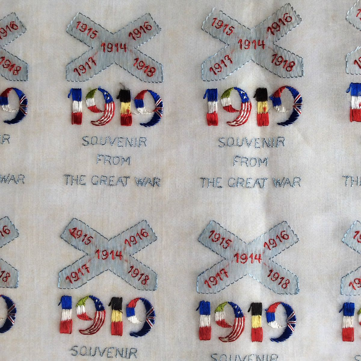 Sheet with multiple, identical images with the text 1919 Souvenir from the Great War, produced by a hand-embroidery machine.