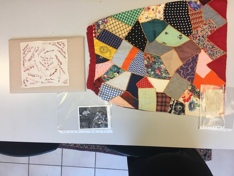 Photograph taken at the TRC on 10th January 2019, showing the Feestrok, the handkerchief from the internmen camp at Stadskanaal, and the photograph of Mrs Boissevain-van Lennep.