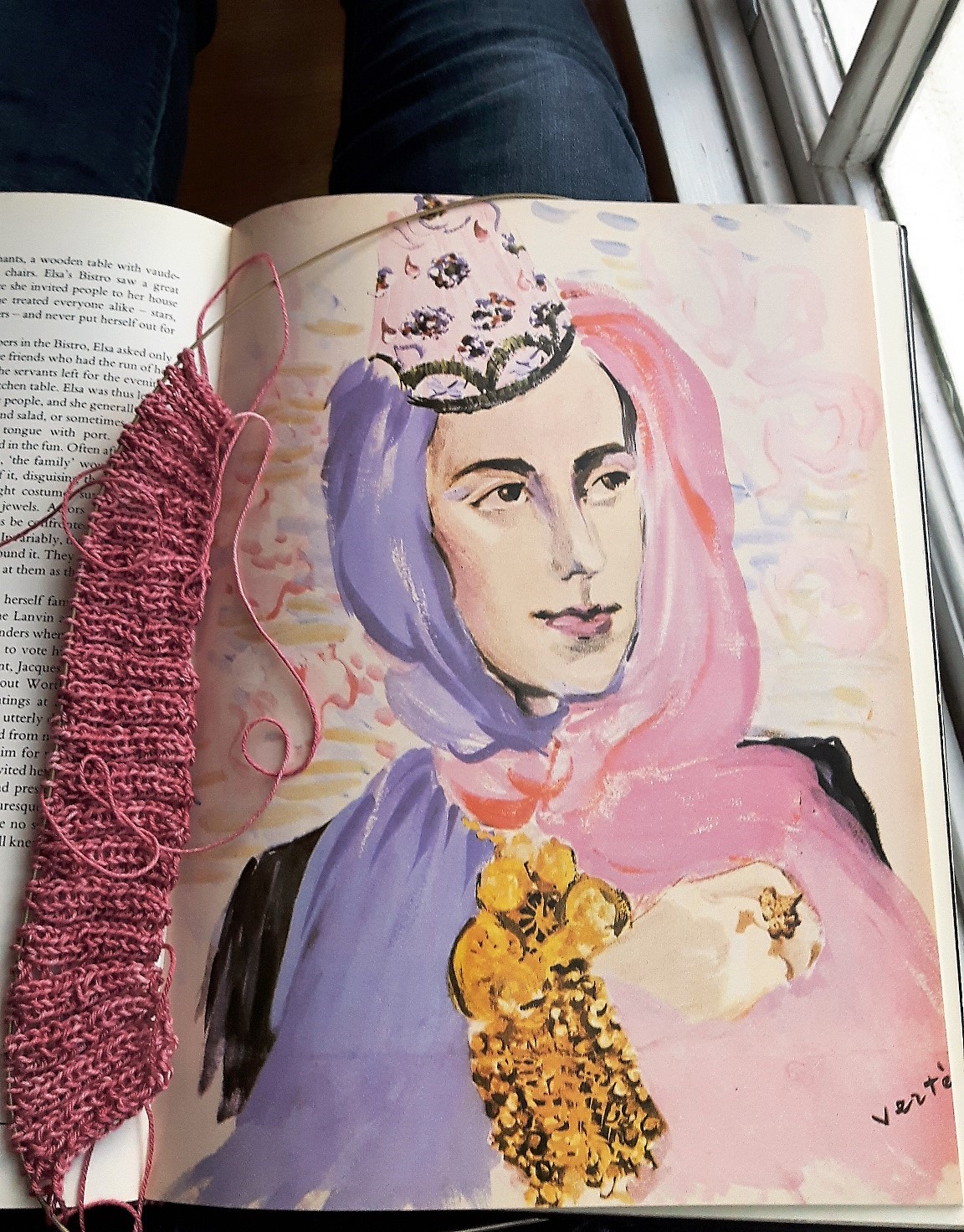 Multitasking: Reading a book on fashion designer Elsa Schiaparelli while knitting a jumper from a 1940s pattern. Photograph: Nelleke Honcoop.