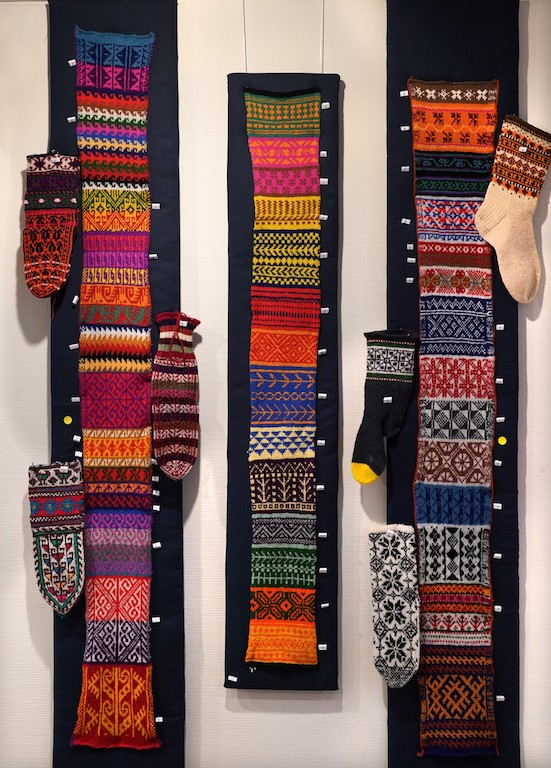 Three hand knitted samplers of designs from socks around the world. Socks&Stockings exhibition, TRC, 2019. Photograph by Joost Kolkman.