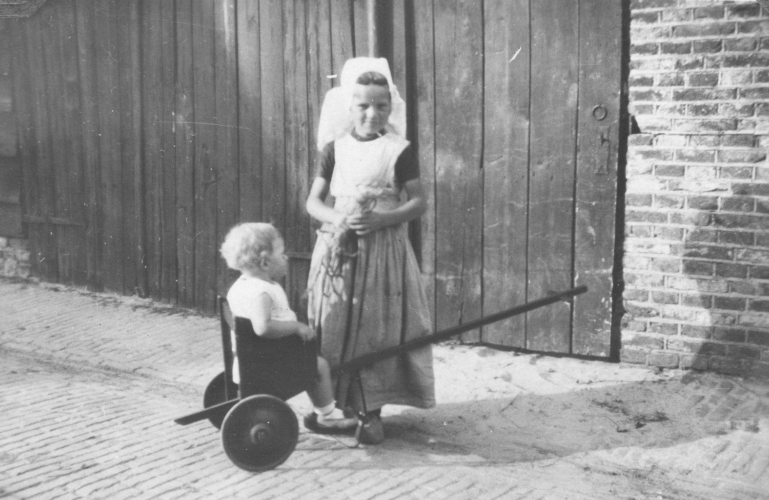 Girl with child from Walcheren in Zeeland, in the southwestern part of the Netherlands, in local costume. Photograph was taken in 1929.