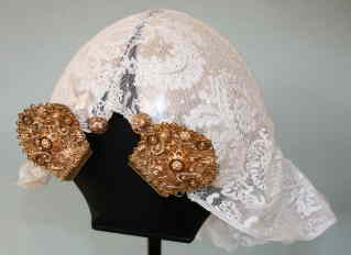 Lace cap with golden jewellery over a silver casque. Northeast Netherlands. TRC collection.