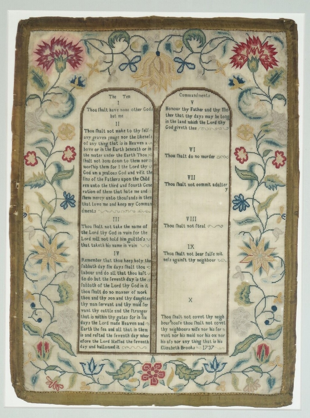 Embroidered sampler worked by Elizabeth Brooks in England, in 1737, showing the two tablets with the Ten Commandments (TRC 2020.3317).