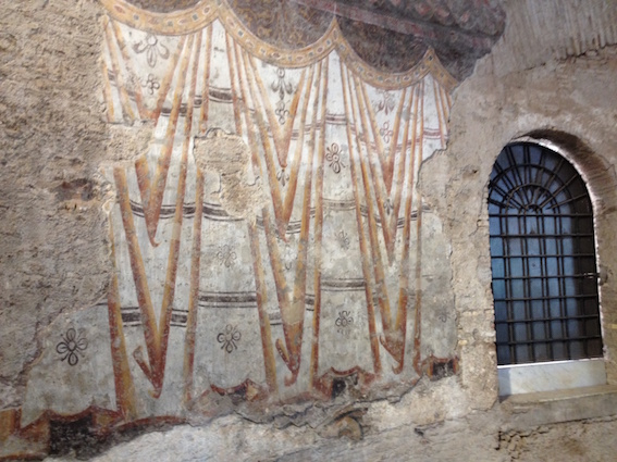 Murals in the 4th century AD Romulus temple, Rome, representing long line of wall curtains. 13th century AD.